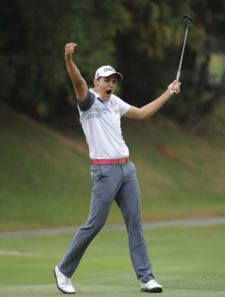 RIO DE JANEIRO, BRASIL - NOVEMBER 9: Rafael Becker of Brazil waves to the gallery of fans after making a eagle on the 18th hole green during the final round of the Aberto do Brasil/Aberto do Atlantico presented by Credit Suisse Hedging-Griffo at Gavea Golf and Country Club on November 9, 2014 in Rio de Janeiro, Brazil. (Enrique Berardi/PGA TOUR)