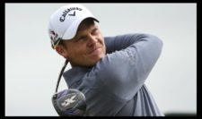 Danny Willett of England tees off on the 5th hole during the third round (Photo by Mike Ehrmann-Getty Images)