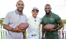 Former Green Bay Packers Antonio Freeman (L) and Ahman Green (R) take part in the Mercedes-Benz Hole-In-One Challenge with Rickie Fowler(C) of the United States during a practice round prior to the 2015 PGA Championship at Whistling Straits