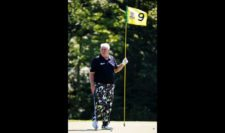 John Daly of the United States holds a pin on the ninth green during a practice round prior to the 2015 PGA Championship at Whistling Straits on August 11, 2015 in Sheboygan, Wisconsin (Photo by Jamie Squire/Getty Images)