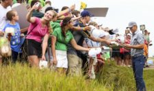 Jordan Spieth of the United States signs autographs for fans during a practice round prior to the 2015 PGA Championship at Whistling Straits on August 10, 2015 in Sheboygan, Wisconsin (Photo by Andrew Redington/Getty Images)