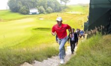 Rory McIlroy of Northern Ireland walks up a set of stairs after a practice round prior to the 2015 PGA Championship at Whistling Straits on August 10, 2015 in Sheboygan, Wisconsin (Photo by Andrew Redington/Getty Images)