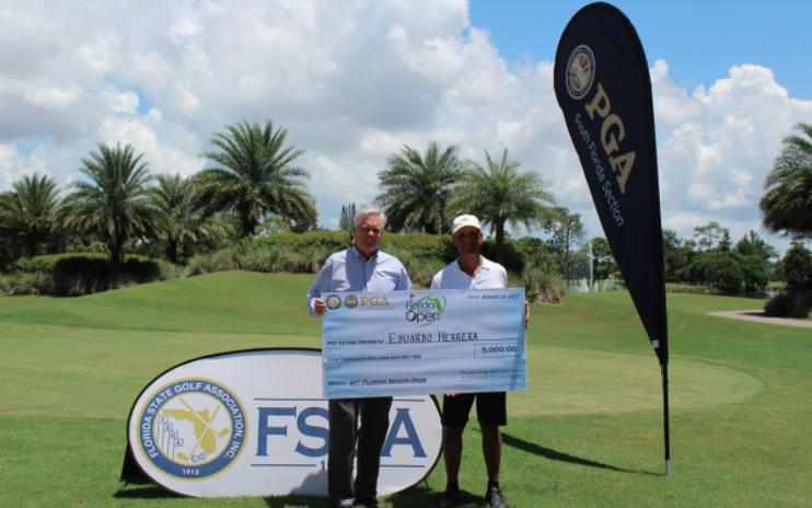 Herrera con el Cheque del premio metálico (cortesía de FSGA)